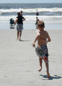 boys run to beach