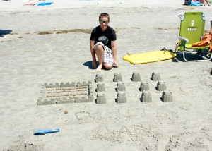 G with sandcastle